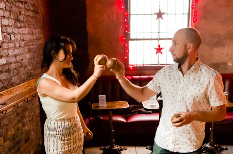 Image for Chiara and Andrew's Skee Ball and Air Guitar Engagement Shoot
