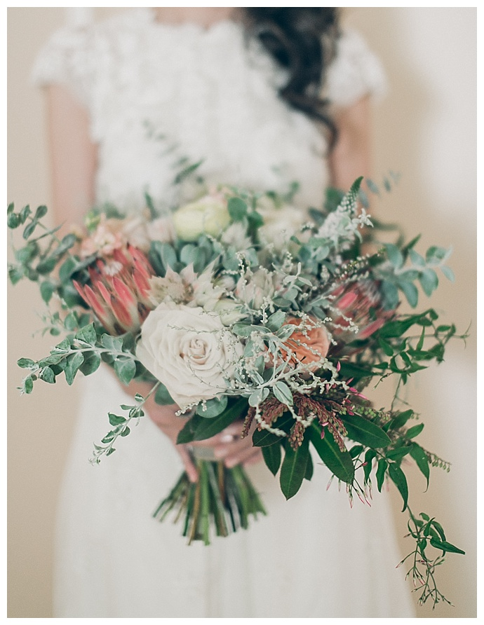 bridal bouquet with roses and protea