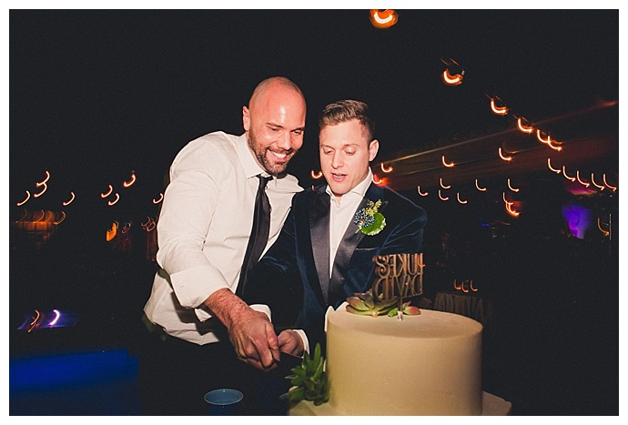 grooms-cake-cutting-new-years-eve-wedding-mike-olbinski-photography