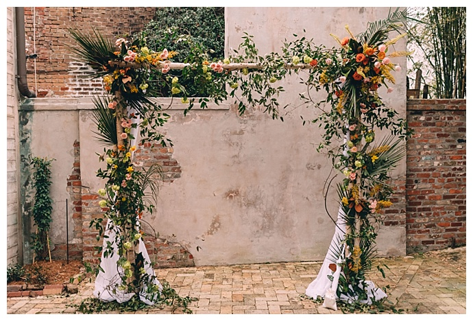 floral-covered-weddig-altar-dark-roux-photography