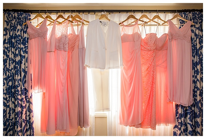 bridal-wedding-suit-and-pink-bridesmaid-mismatched-dresses