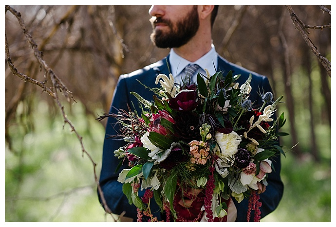 protea-and-blue-thistle-wedding-bouquet-carnefix-photography