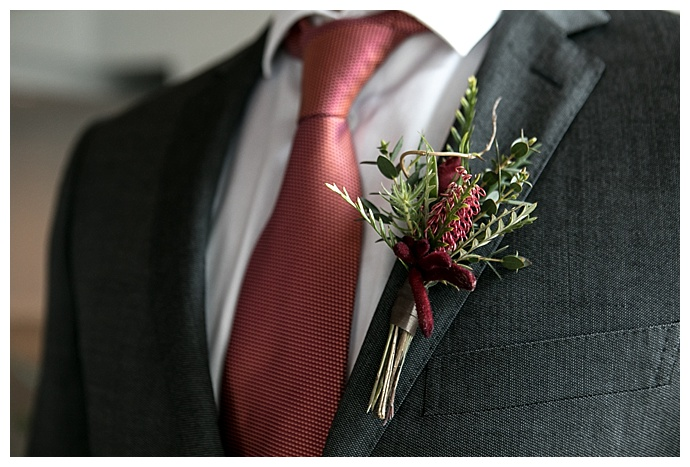 red-and-green-boutonniere-hattie-root-photography