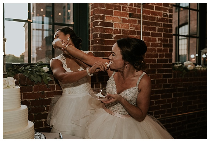 brides-smashing-wedding-cake-in-faces-cheyenne-kidd-photography