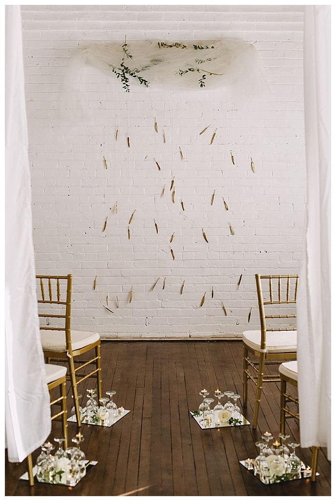 gold-feather-ceremony-backdrop-ampersand-grey-photography