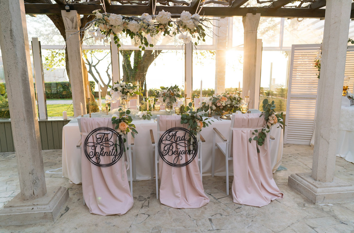 to-infinity-and-beyond-wedding-chair-signs
