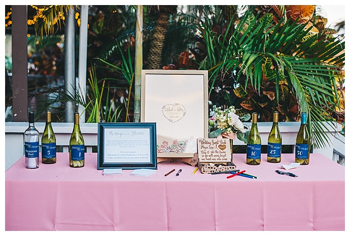 blush and navy wedding welcome table