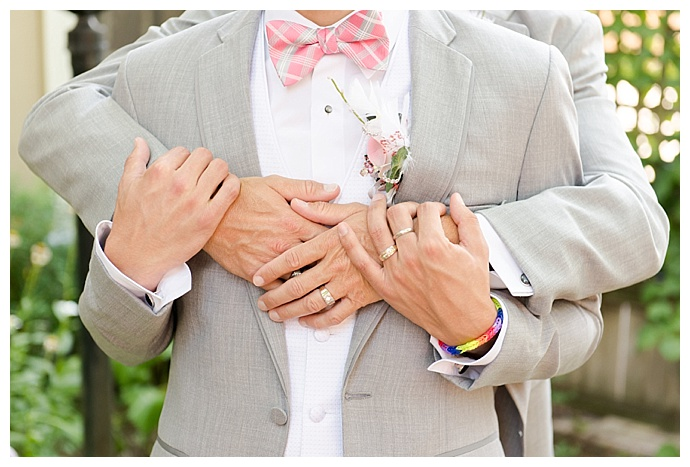 gray wedding suit with pink bow tie