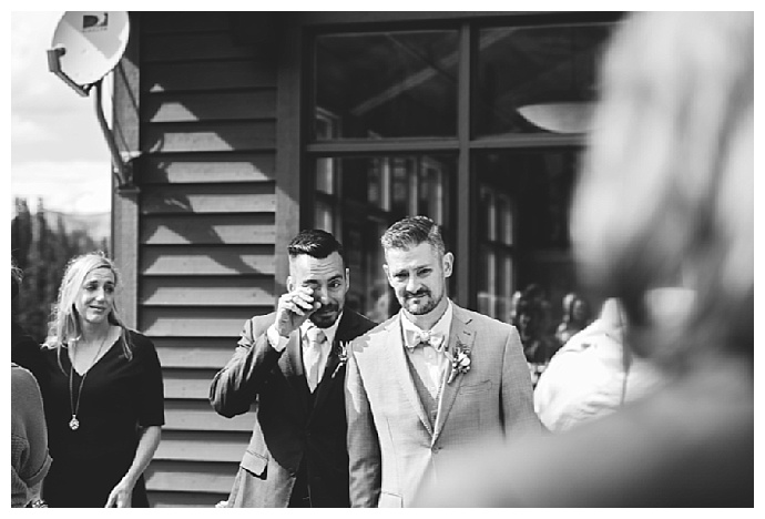 grooms walking down the aisle together