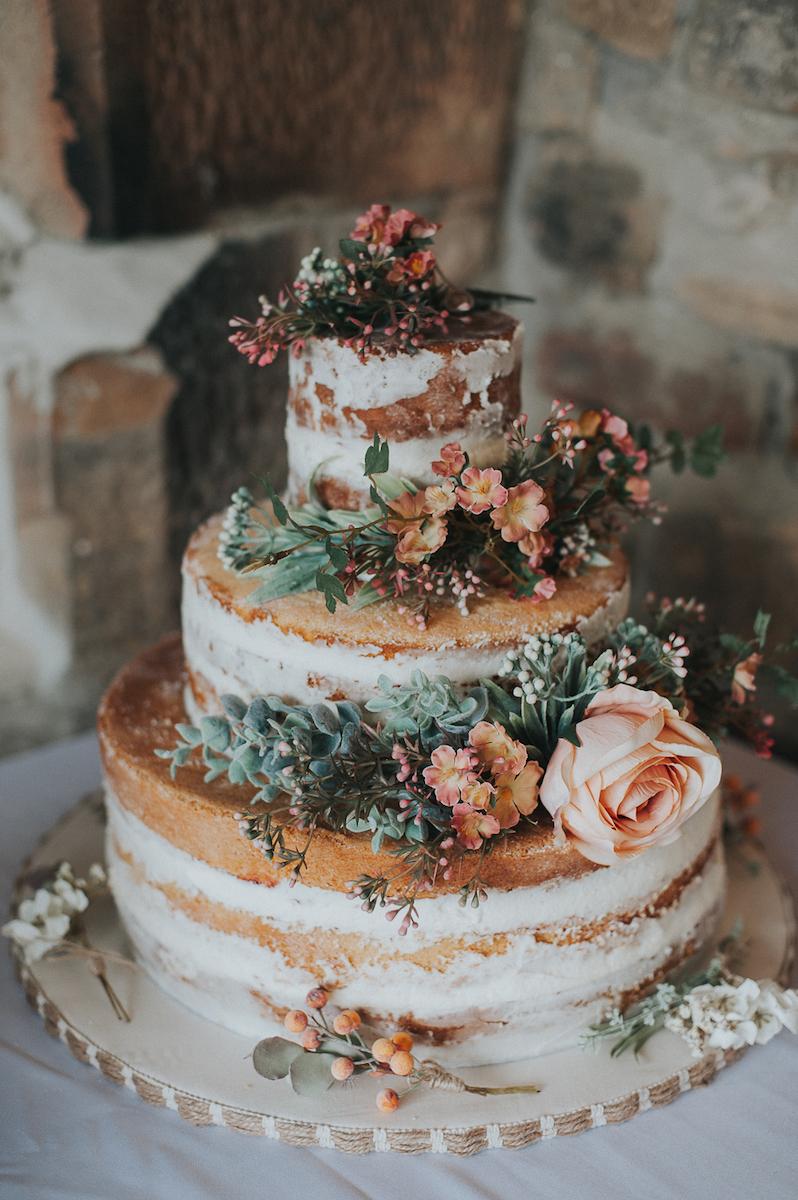 semi-naked-wedding-cake-with-fresh-flowers