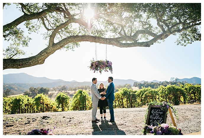 slotography-florals-hanging-from-tree-ceremony-decor