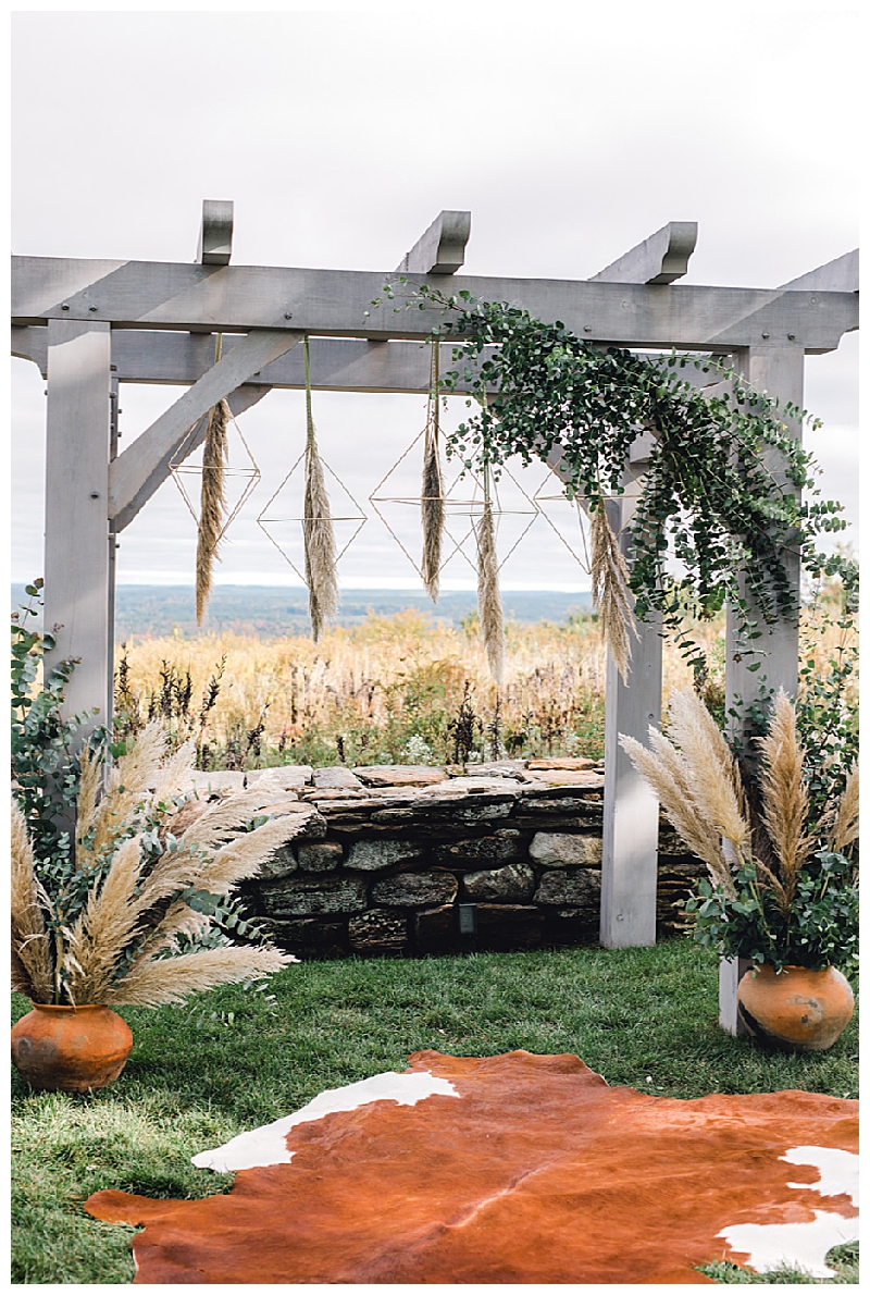 Ceremony Arbor with Cowhide Rug