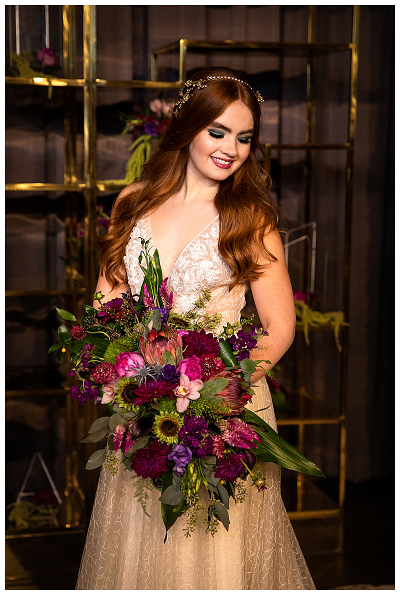 flora-bridal-wedding-dress-with-purple-and-red-bouquet
