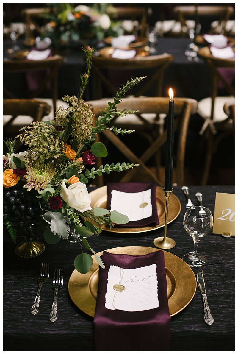 metallic-burgundy-tablescape-with-taper-candles