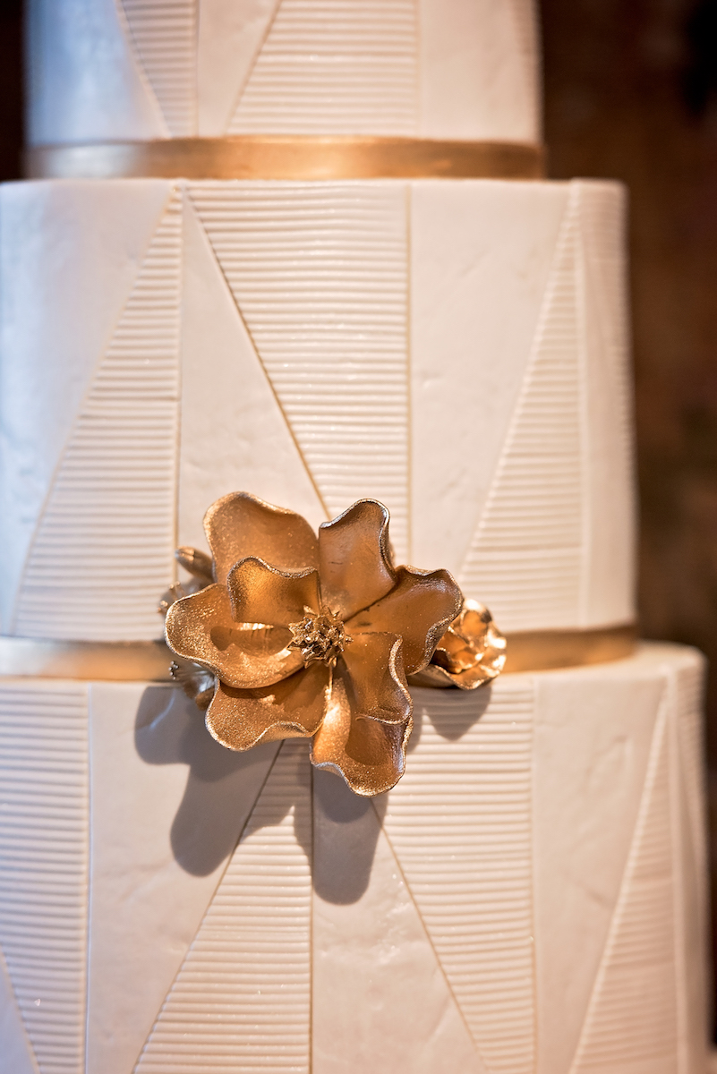 textured-white-and-gold-wedding-cake-jamie-reinhart-photography