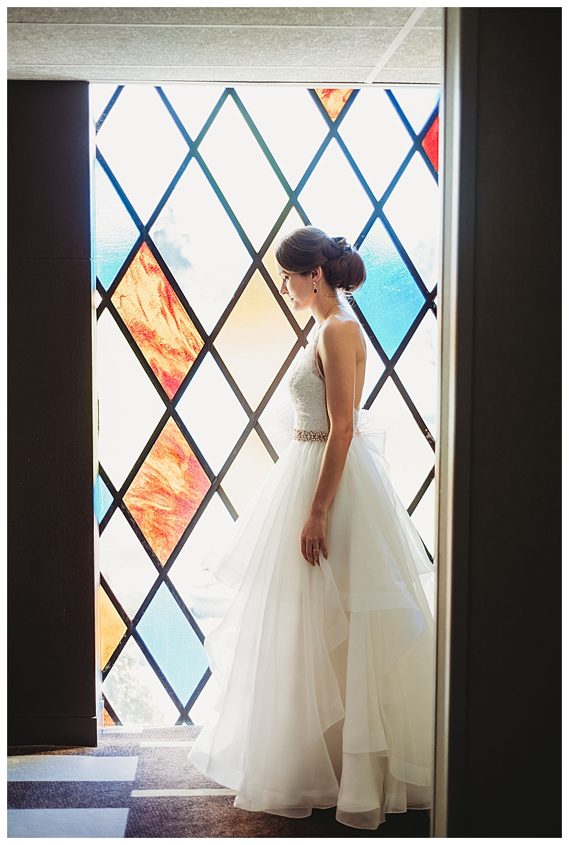 bride-in-front-of-stainglass-window