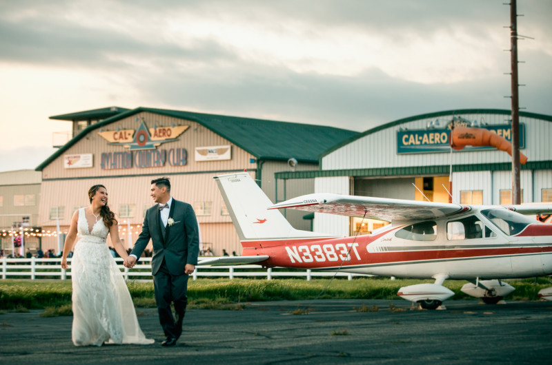 Image for This Coachella-Themed Wedding Took Place in an Airport Hangar
