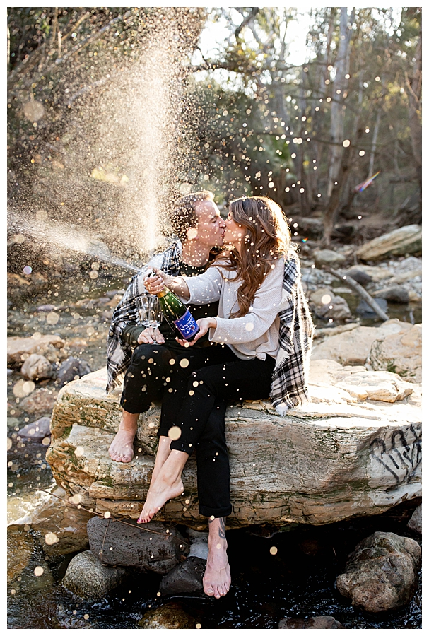 champagne-spray-engagement-photos