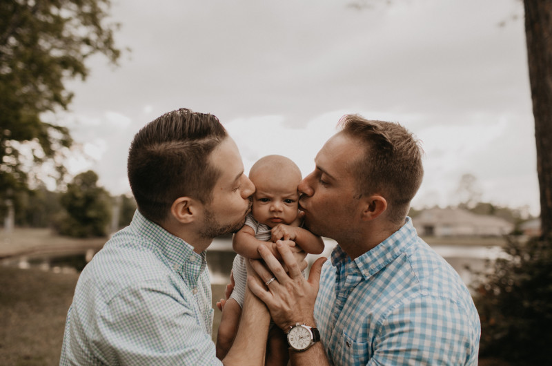 Image for New Dads Celebrate With a Rainbow Flag Newborn Session