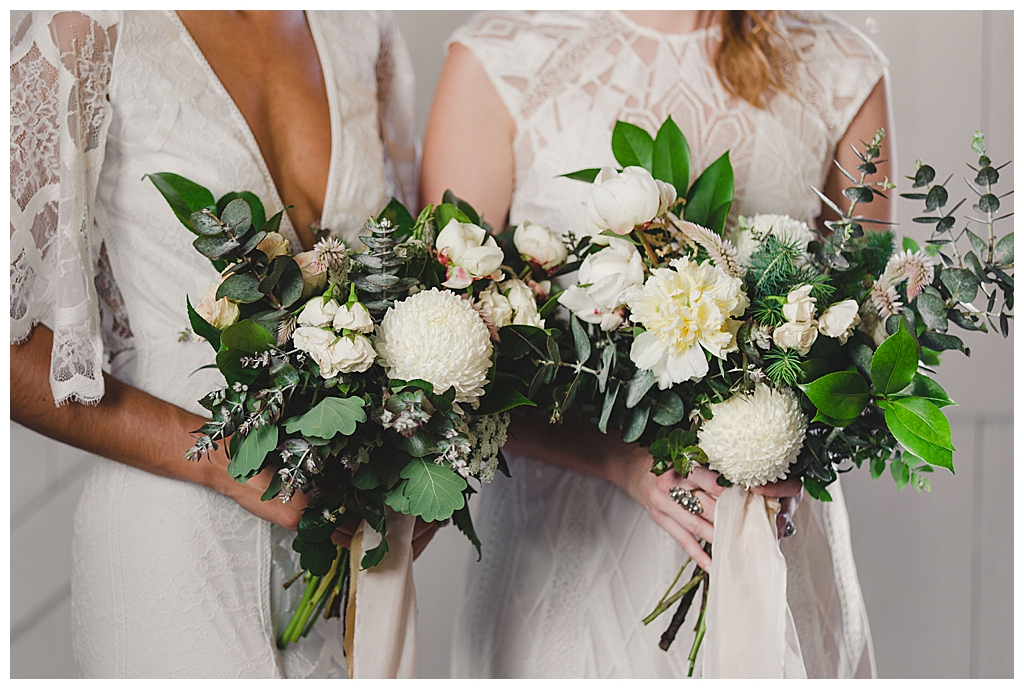 two-bridal-bouquets-with-greenery-and-white-flowers