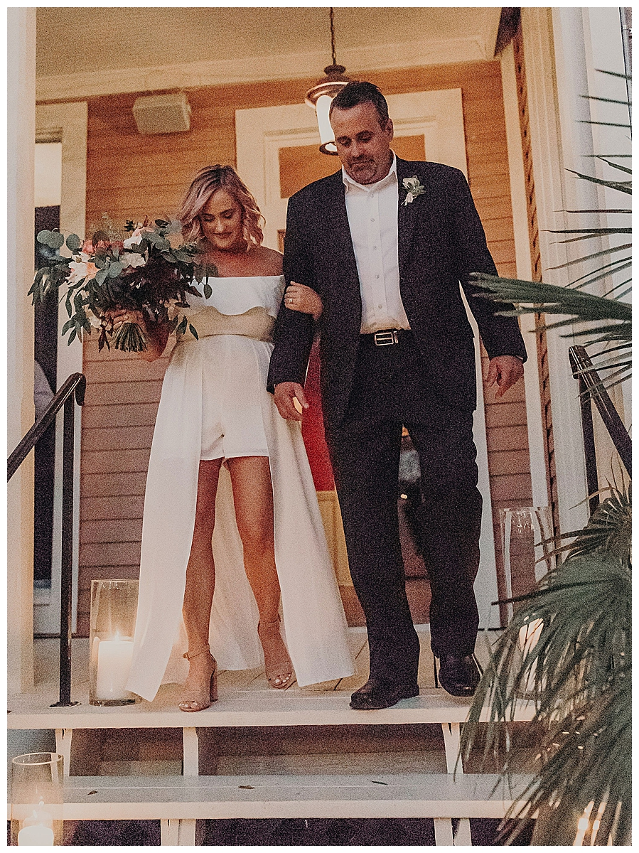 father-walking-daughter-down-wedding-aisle