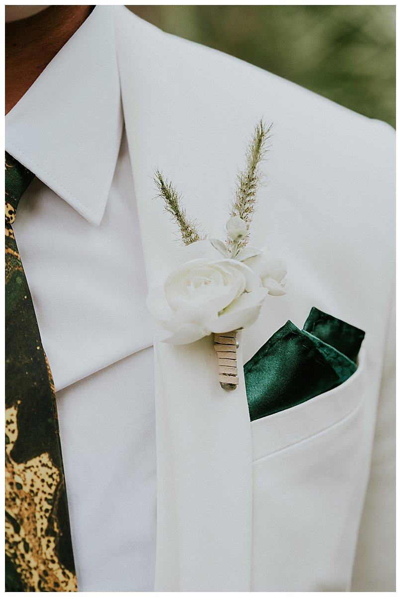 white-suit-with-green-pocket-square