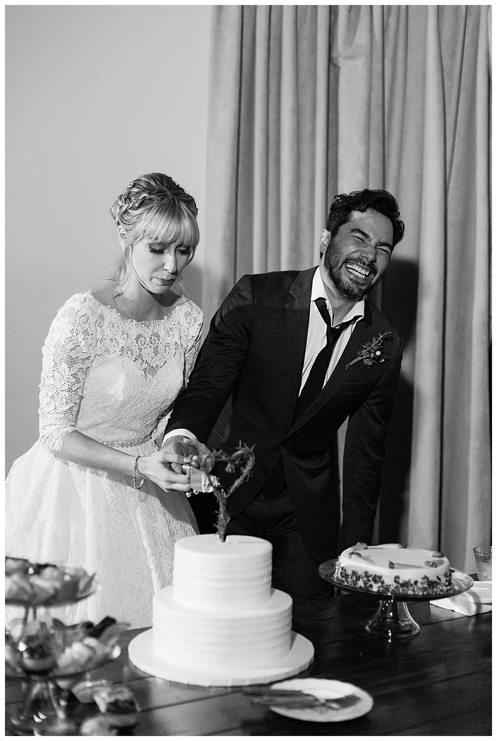 black-and-white-cake-cutting-wedding-photography