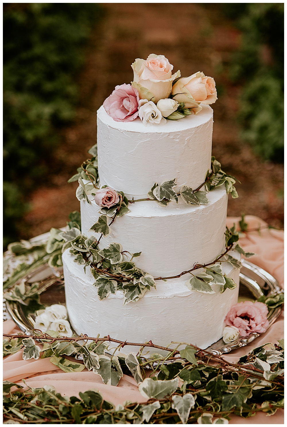 white-buttercream-wedding-cake-with-flowers