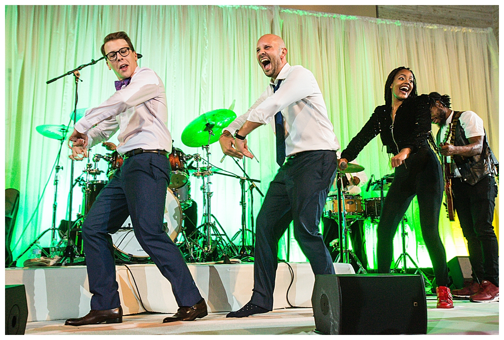 grooms-dancing-on-stage-wedding-reception