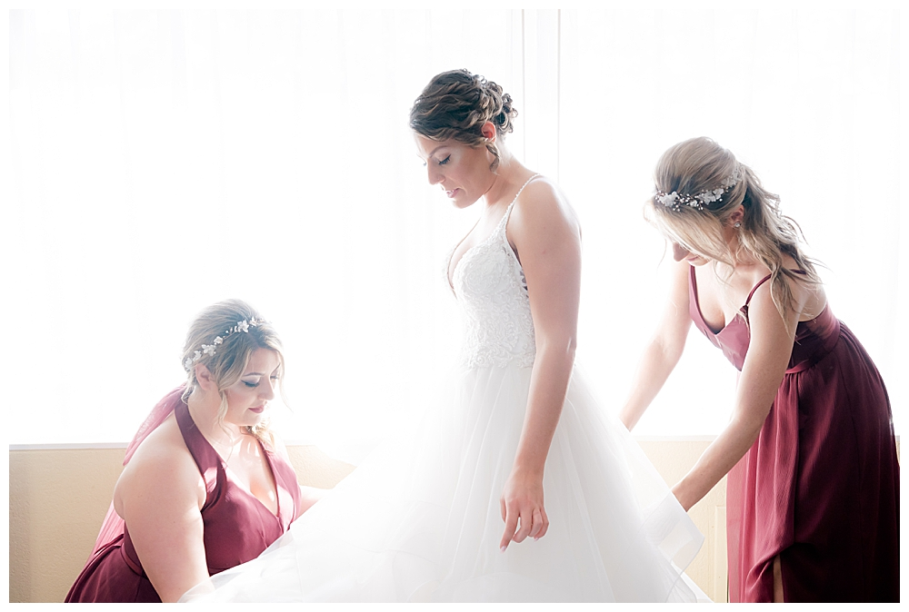bride-getting-ready-with-bridesmaids
