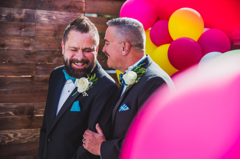 Image for Colorful Wedding with an Epic 7-Foot Floral Heart Designed By One of the Grooms