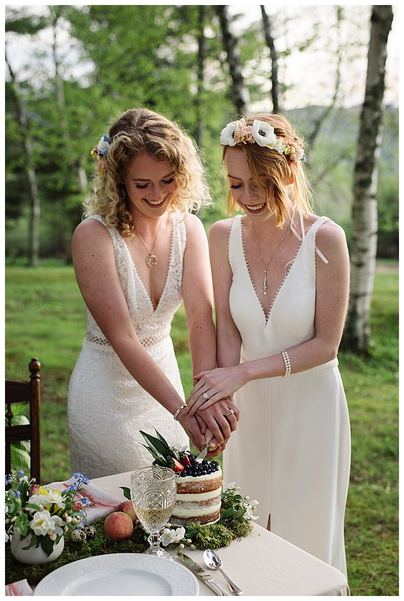 two-brides-cutting-cake