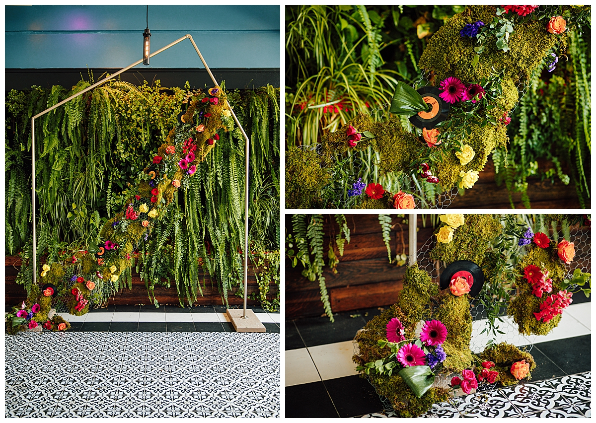 wedding-ceremony-backdrop-with-florals-and-records