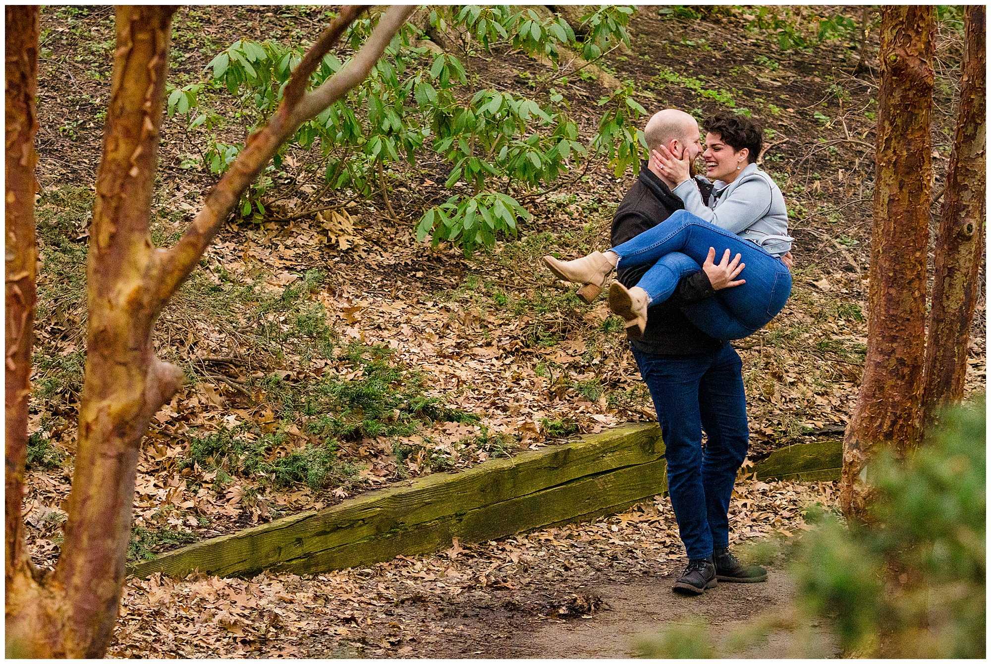 A man carries his fiance in highland park after he just proposed