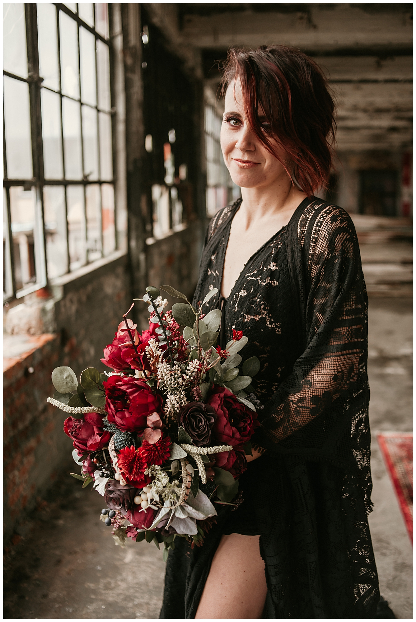 black-wedding-dress-with-red-bouquet