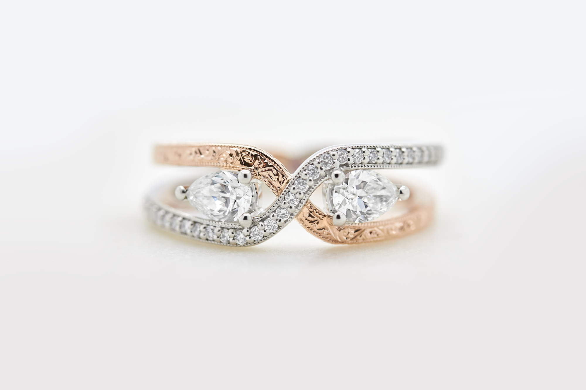 double band engagement ring with two pear diamonds