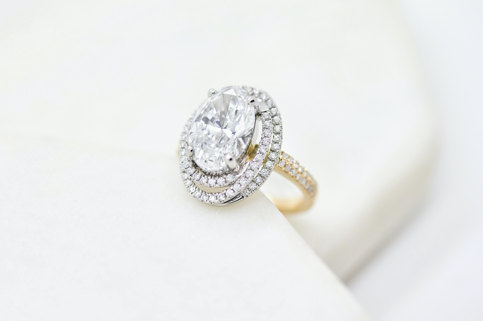 double halo engagement ring in platinum and rose gold