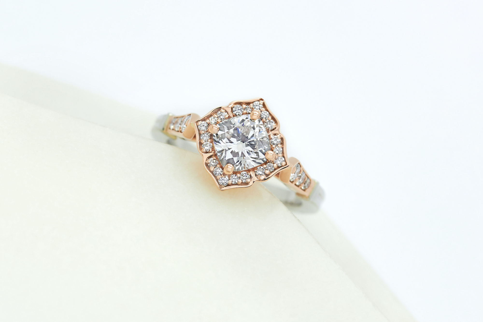 mixed metal engagement ring with organic inspired halo