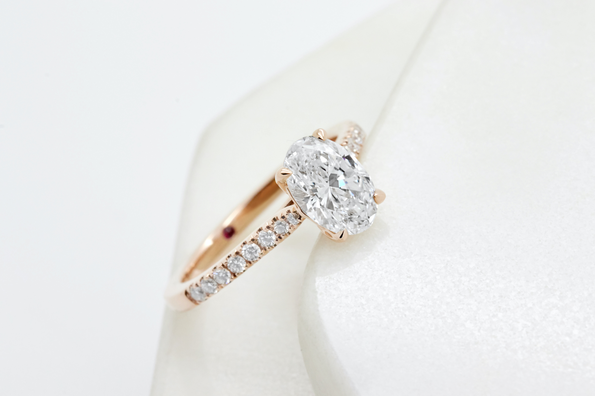 oval diamond pave engagement ring in rose gold