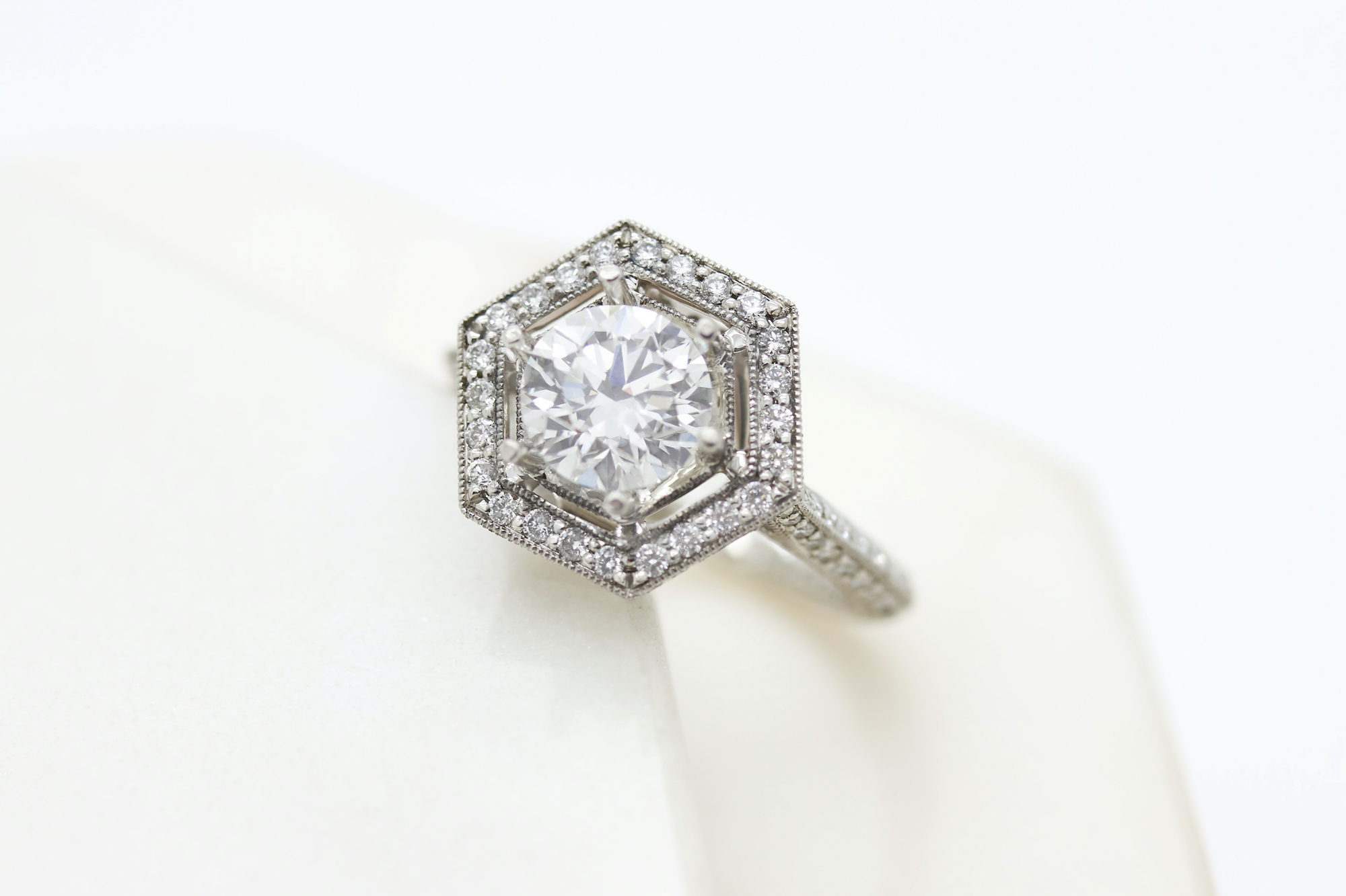 round diamond and hex halo vintage engagement ring