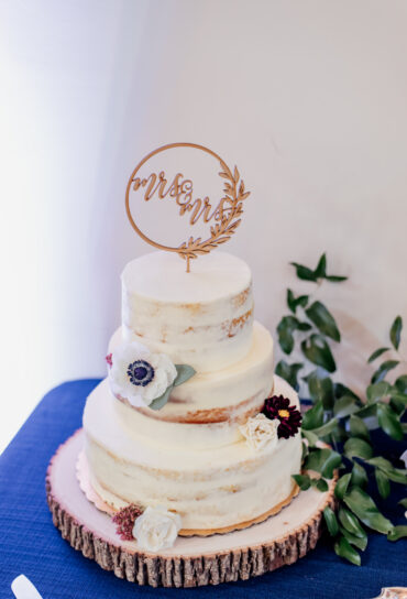 Dusted Naked Wedding Cake with Mrs. and Mrs. Cake Topper