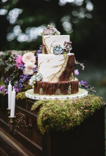 Faux Wood Wedding Cake with Glitter and Flowers