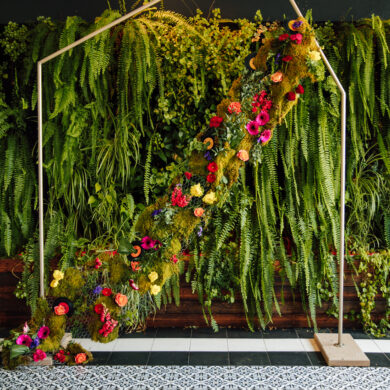 Gold Industrial Pipe Ceremony Backdrop with Moss Florals and Ferns