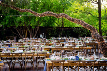 Outdoor Wedding Reception with Farmhouse Tables and Twinkly Lights