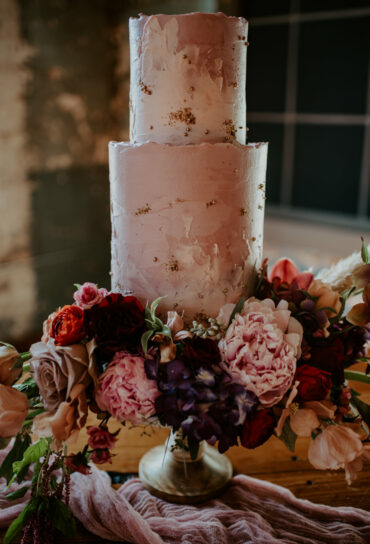 Pink and White Watercolor Wedding Cake with Gold Flecks