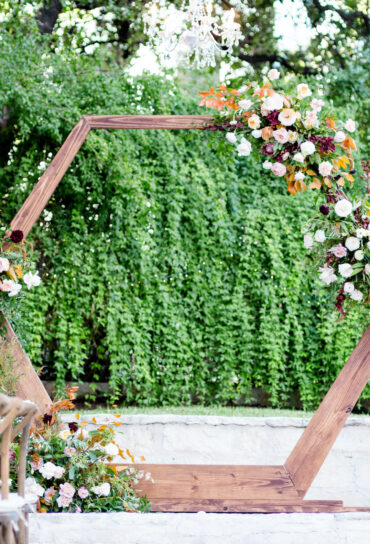 Wooden Geometric Wedding Ceremony Backdrop with Flowers